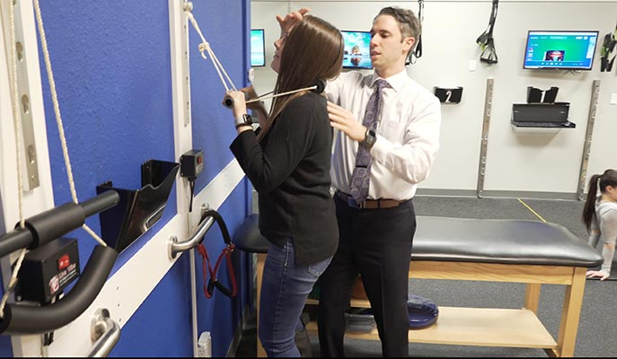 Chiropractor The Colony TX Andrew Oteo Helping Patient