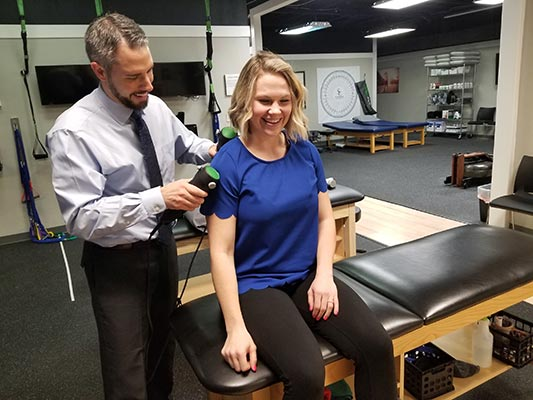 Chiropractor The Colony TX Andrew Oteo with Patient